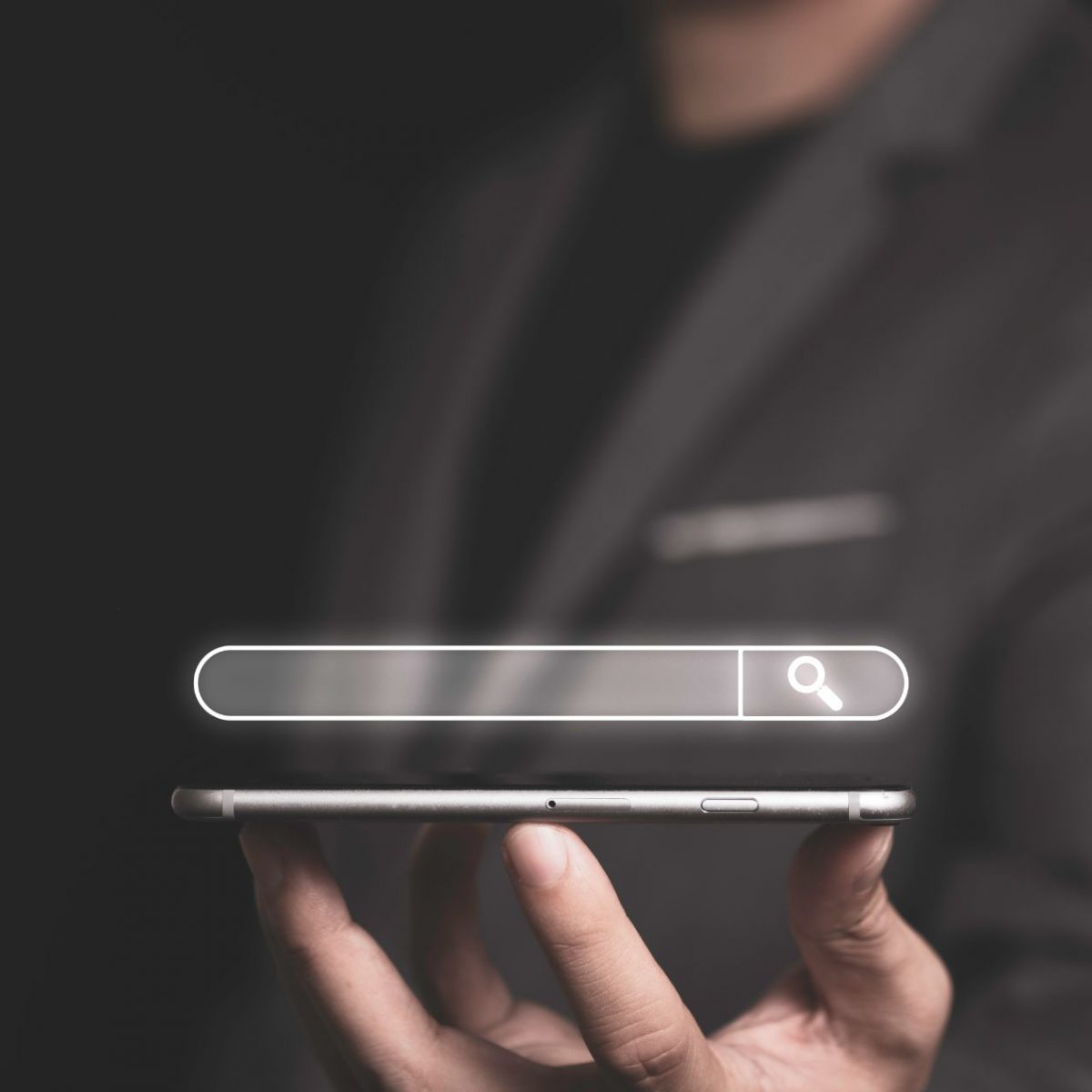 search-engine-optimisation-seo-concept-businessman-holding-smartphone-using-input-keyword-searching-find-information (1)